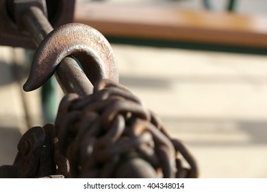 Brown hook and chain on a bar