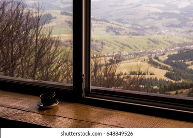 brown hot cup, drink on the background of a mountains / reinforcement force and mood