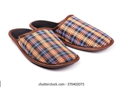 Brown house slippers isolated on white background