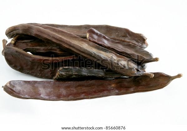 brown husk of carob
