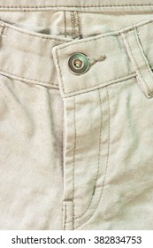 Brown jeans front side,close up detail.