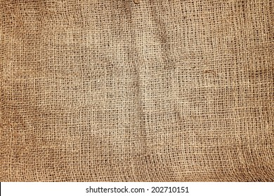 Brown jute sackcloth with subtle light.Natural texture background