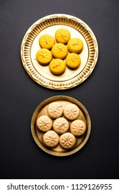 brown and Kesar Pedha or Peda is an Indian traditional sweet dish made from milk/khoya and saffron