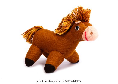 Brown knitted hobby horse isolated on white background.