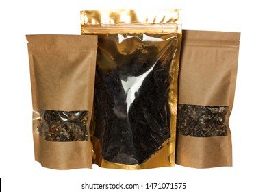 Brown kraft paper and golden foil pouch bags front view isolated on a white background. Packaging for foods and goods, mock-up. Packs with clasps and windows for tea, coffee beans and weight products.