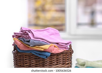 Brown laundry basket with clothes indoors