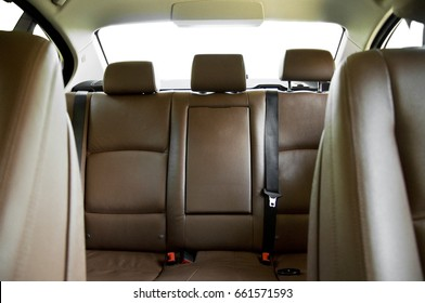 Brown leather back passenger seats in modern car, car interior