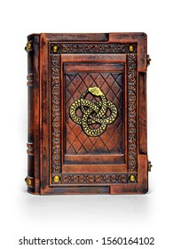 Brown leather book cover with metal pins in the corners and gilded snake captured while stand up isolated