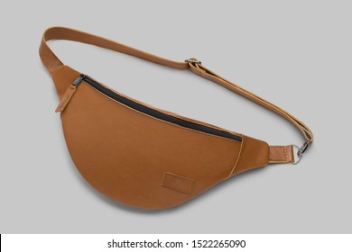 Brown leather bum bag on gray  background