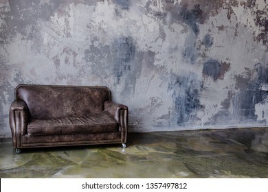 Brown leather couch in loft interior