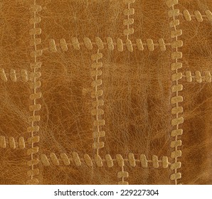 brown leather, decorated with imitation seams. Useful as background