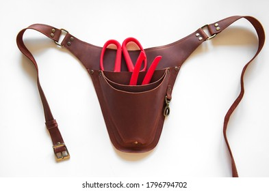 Brown leather floral holster with tools on white background   - Shutterstock ID 1796794702