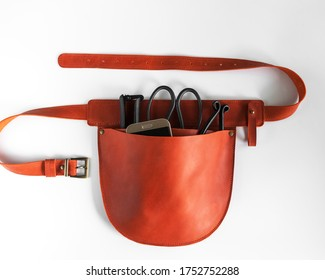 Brown leather garden holster with garden tools on a white background - Shutterstock ID 1752752288