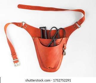 Brown leather garden holster with garden tools on a white background - Shutterstock ID 1752752291