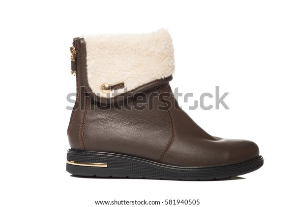 Brown leather high boot isolated on white background