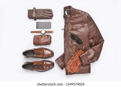 Brown leather jacket with shoes ,handbag and fashion sunglasses,gloves ,watch,cell phone on white background
