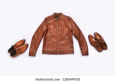 brown leather jacket  and two leather shoes –white background