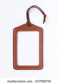 Brown leather label tag with string, isolated on the white background.