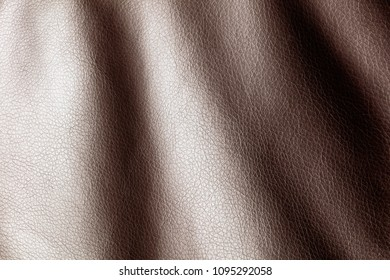 Brown leather material as an abstract background
