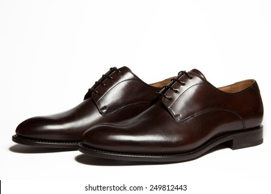 Brown leather men's shoes isolated on white background