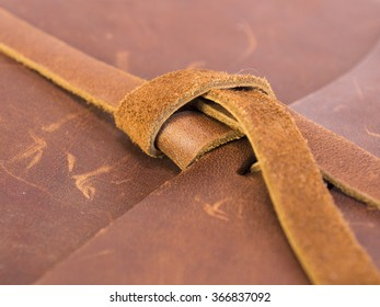 Brown leather notepad details. Close up.