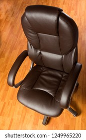 Brown leather office chair - Top view with deformity