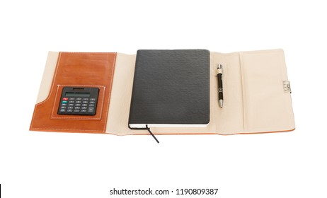 Brown Leather PU Agenda Diary Notebook with pen holder isolated on white background. In stationery, diary or appointment book is small book containing a main diary section with space for each day