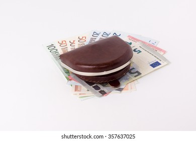 the brown leather purse with banknotes