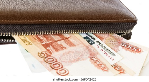 brown leather purse with Russian money, the ruble, finance, white background