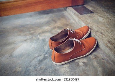brown leather shoes fashion on cement floor