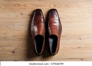 brown leather shoes for men, luxury leather shoes on wooden background