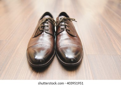 brown leather shoes on floor