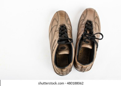 brown  leather shoes on a white background ,old sneaker