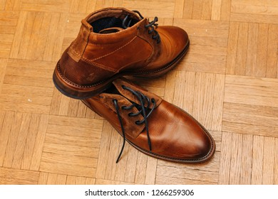 brown leather shoes on wooden background