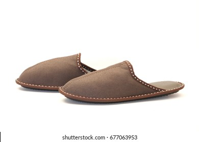 Brown leather slippers isolated on white background