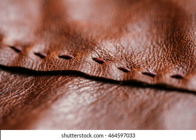 Brown Leather with Stitching. Fine Leather Crafting, Handcrafts Leather Work. Background, Textured and Wallpaper. Close up, Selective Focus.