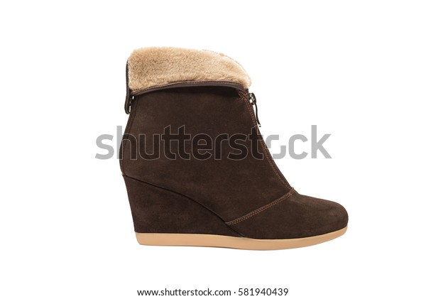 Brown leather suede high wedge boot isolated on white background