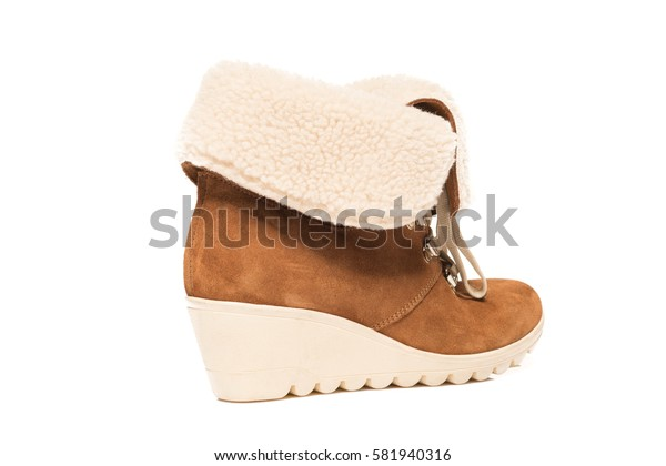 Brown leather suede wedge boot isolated on white background