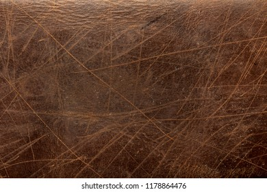 brown leather texture close up may used as background .