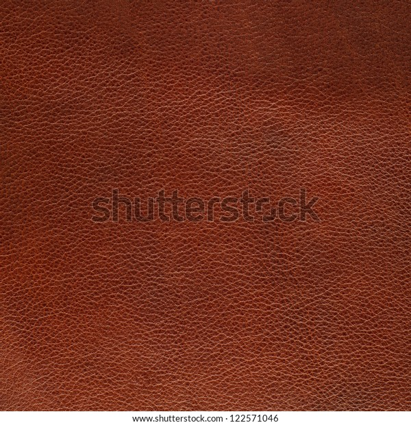 Brown leather texture closeup background.