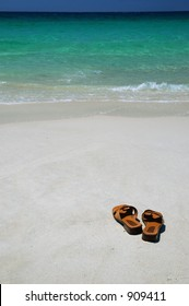 Brown Leather Thongs on a Beach