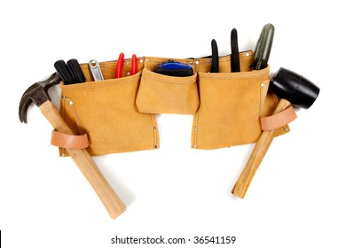 A brown leather toolbelt with assorted tools including a hammer, screwdrivers, pliers, tape measure etc.
