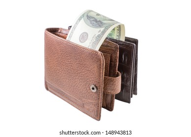 The brown  leather wallet with dollars is photographed on the close-up