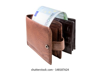 The brown  leather wallet with euro is photographed on the close-up