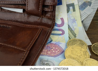 Brown leather wallet with money euro inside it. Macro photo.