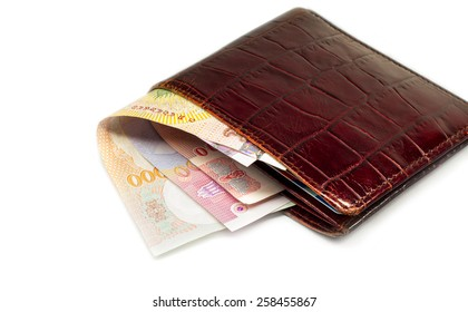 Brown leather wallet with money thai