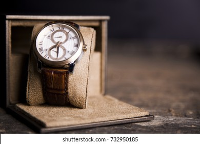 Brown  LEATHER WATCH, VINTAGE STYLE WRIST WATCH, MEN'S LEATHER WATCH on wooden background blur.