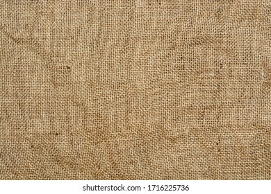 Brown linen fabric, texture of the old, rough burlap for the background.