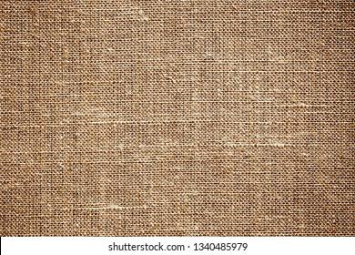 Brown linen textile background. Fiber rustic fabric retro texture.