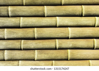 Brown long bamboo sticks pattern. Natural horizontal wooden plant pipes background.